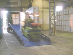 Fork lift loading a container